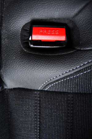 fasten your seat belt concept with red button and black copyspace photo