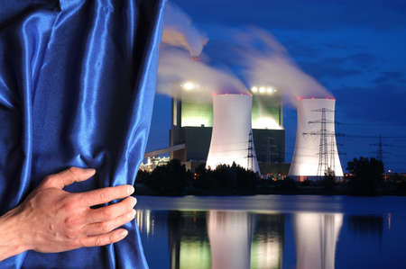 power plant and blue curtain showing pollution or energy supply concept photo