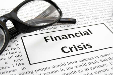 meltdown: financial crisis concept with fake newspaper showing economic downturn