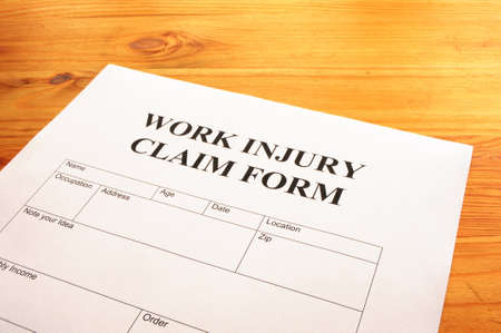 sue: work injury claim form showing business insurance concept