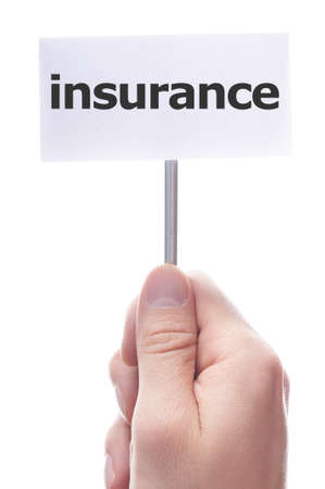 policies: insurance concept with hand word an paper