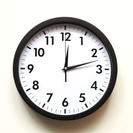 timing: time concept with watch or clock on white wall Stock Photo