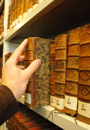 old books in a library with hand showing education concept Stock Photo - 7055753