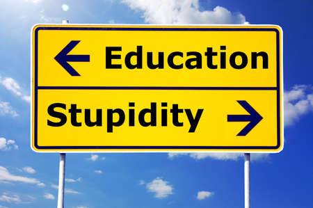 education and stupidity concept with yellow road sign                                     photo