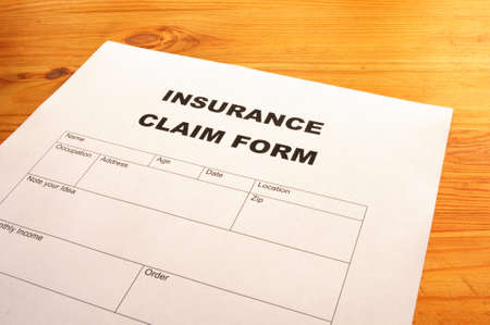 insurance claim for on desk in office showing risk concept Stock Photo - 7092919