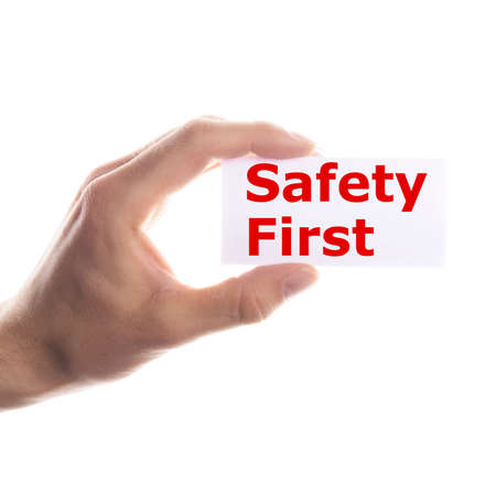 safety first: safety first concept with hand word and paper Stock Photo