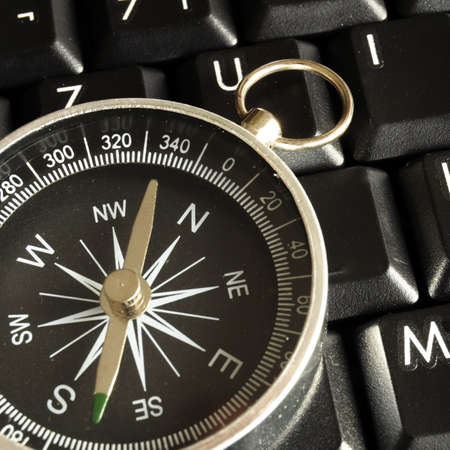 internet or online concept with computer keyboard and compass photo