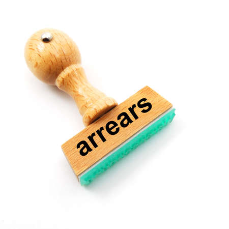 arrears: arrears or debt concept with stamp in office Stock Photo