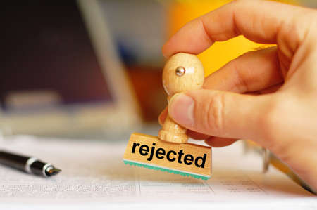 rejected concept with stamp in business office showing rejection concept photo