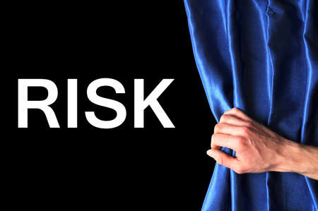 safety first concept showing risk behind blue curtain Stock Photo - 7110728