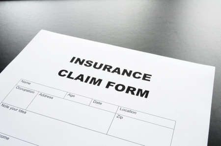 insurance claim for on desk in office showing risk concept Stock Photo - 7110905