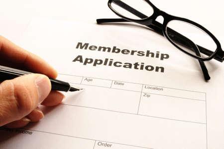 join: membership application form on desktop in business office