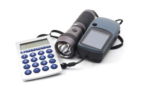 geocaching still life with gps and flashlight isolated on white background photo