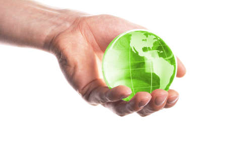hand holding globe to protect the fragile environment Stock Photo - 7110755