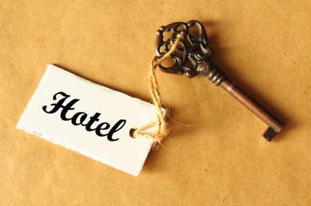 travel concept with hotel key and tag or label Stock Photo
