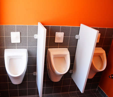 toilet bowl with black and orange wall for copyspace Stock Photo - 7110898