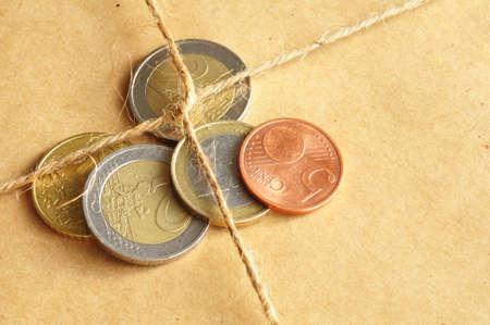 forwarding: forwarding charges or shipping money concept with coins and parcel