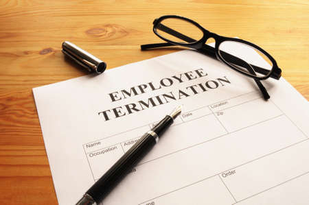 layoff: employee termination form on desk in business office showing job concept Stock Photo