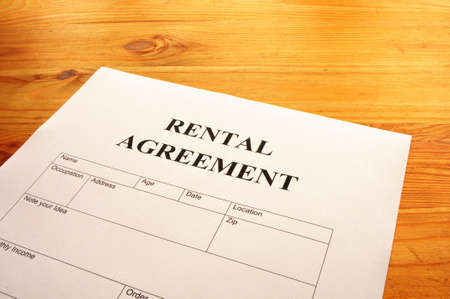 law business: rental agreement form on desktop in business office showing real estate concept