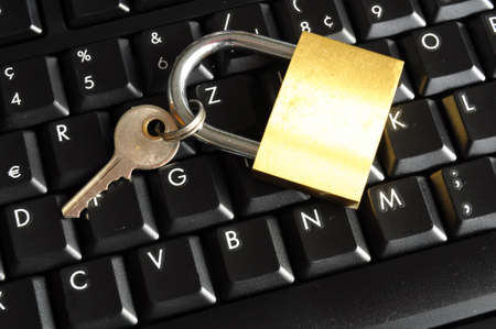 secure online banking or internet firewall concept with padlock and keyboard photo