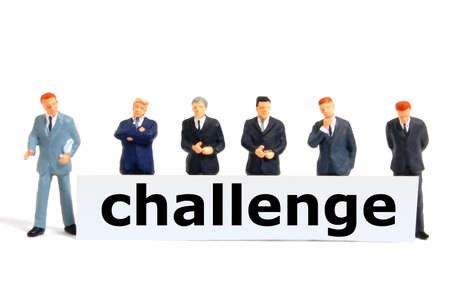 business challenge with small toy man isolated on white Stock Photo - 7127270