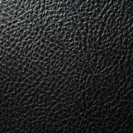 black leather texture background or wallpaper with copyspace photo