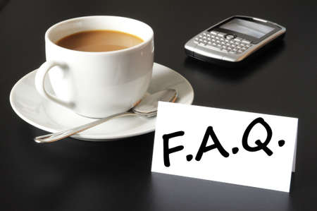 asked: faq or frequently asked question concept with cup of coffee on black
