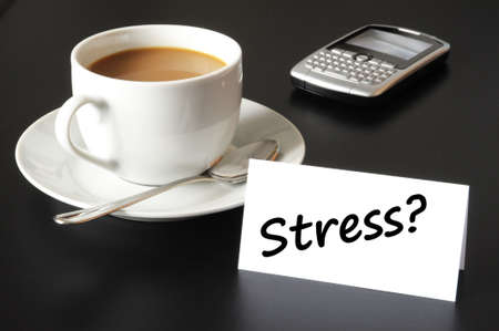 stress in business office concept with cup of coffee on black background Stock Photo - 7183660