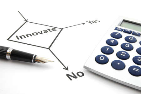 business innovation concept with flowchart and pen on white photo