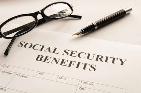 social work: social security benefits form showing financial concept in office Stock Photo