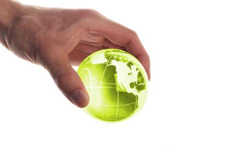 hand holding globe to protect the fragile environment photo