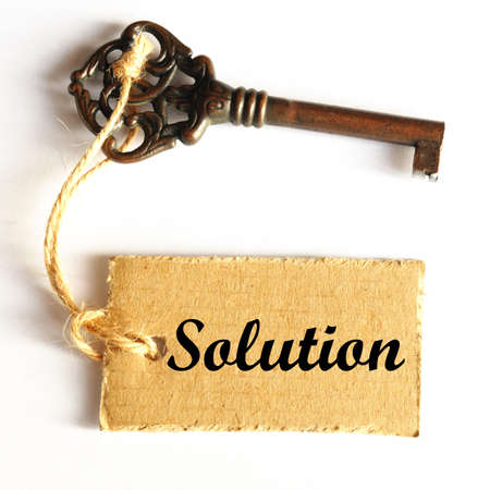 key to solution concept with old grunge label or tag photo