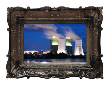 picture of industry at night in image frame on a wall