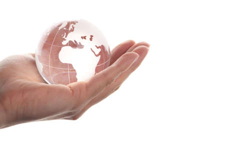 holding globe: hand holding globe to protect the fragile environment