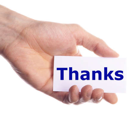 thank you or thanks concept with hand word and paper photo