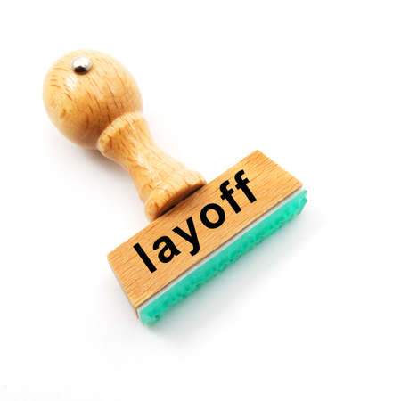 layoff: layoff stamp in business office showing unemployment concept