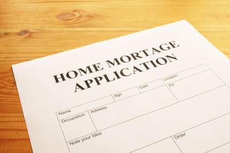 mortage: home mortage application form on desktop in office showing real estate concept