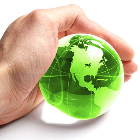 warming: ecology concept with hand and glass globe isolated on white background
