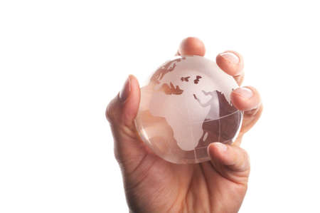 environmental protection or business concept with glass globe in hand isolated on white photo