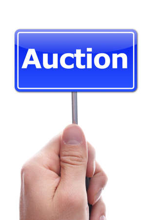 online auction: buy or sell on auction concept with hand holding paper  Stock Photo