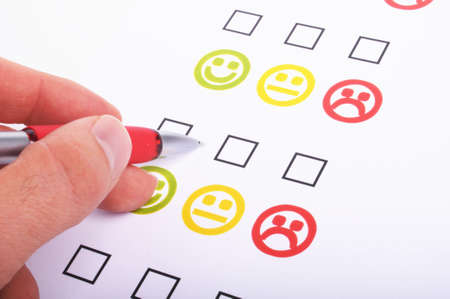 hand pen and checkbox or tickbox with smilie Stock Photo - 7208618