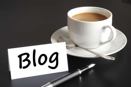 blogs: blog and cup of coffee with copyspace showing internet or rss concept
