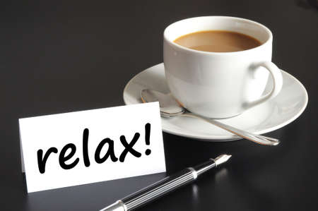 relax or break concept with cup of coffee on black background Stock Photo