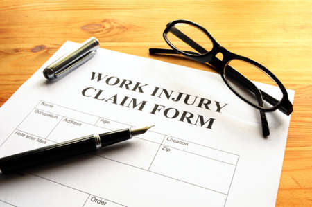 health care protection: work injury claim form showing business insurance concept