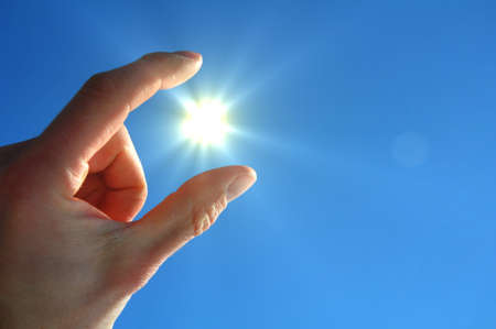 hand sun and blue sky with copyspace for text message photo