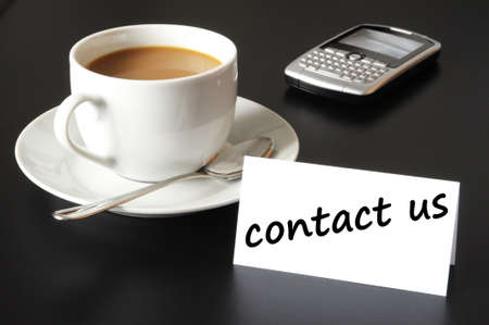 email contact: contact us and coffee cup showing business support concept