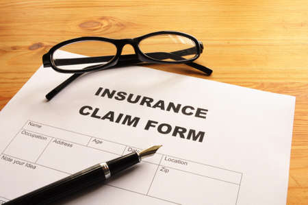 insurance claim for on desk in office showing risk concept Stock Photo - 7287478