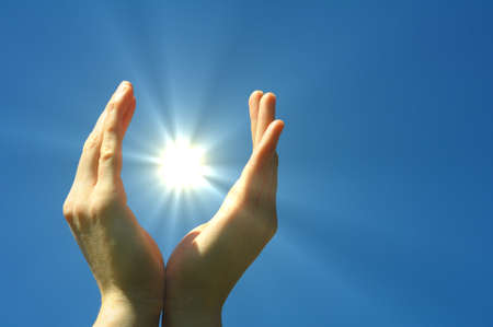 hand sun and blue sky showing hope peace or freedom concept Stock Photo - 7287416