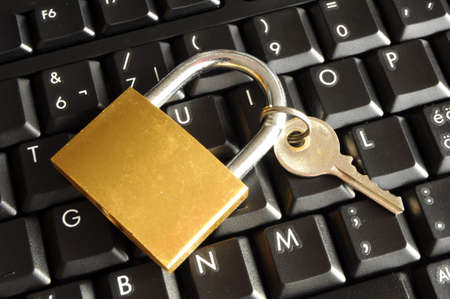 internet security concept with padlock on black keyboard Stock Photo - 7287484