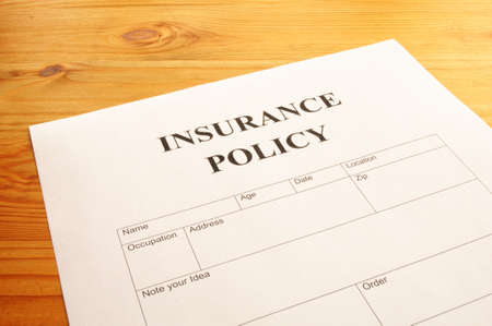 insurance policy form on desk in office showing risk concept Stock Photo - 7322287